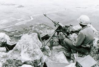 A machine gunner of the 101st Airborne sits with a commanding view near Tuy Hoa (II Corps).
