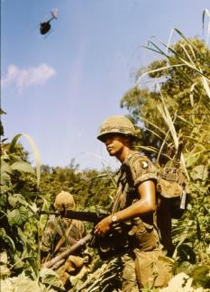 A Radio Telephone Operator (RTO)of the 101st Airborne on patrol near Mai Loc, twelve miles from the DMZ.