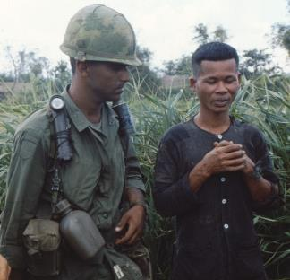 A member of the 101st Airborne questions a Viet Cong suspect during operation Van Buren.