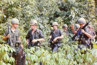 A squad of the 173rd Airborne on a search and destroy mission in Binh Duong province north of Saigon.