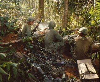 Three soldiers of the 173rd Airborne take a rest from their assault on Hill 875, near Dak To (Central Highlands).