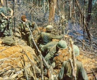 Paratroopers of the 4th Battalion, 173rd Airborne prepare defensive positions against a possible NVA counter-attack on Hill 875 near Dak To (Central Highlands).