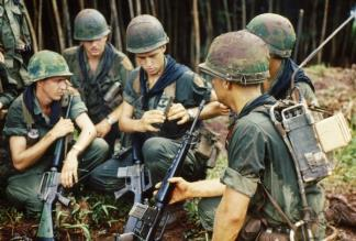 A rifle squad of the 1st Battalion, 2nd Infantry, 1st Infantry Division stop to examine a PRT-4 radio transmitter and PRR-9 receiver.