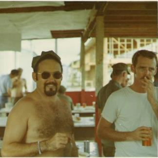 Seawolf door gunner Bill Rutledge, on the left, in Binh Thuy in April 1970.