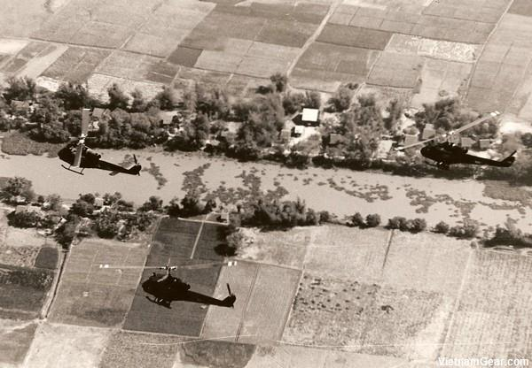 Three Seawolf helicopter gunships on a search and destroy mission above the Uminh Forest in the Mekong Delta.