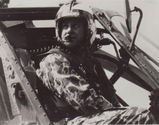 A duck-hunter (Beo-Gam) clad pilot looks out from his helicopter after touching down.