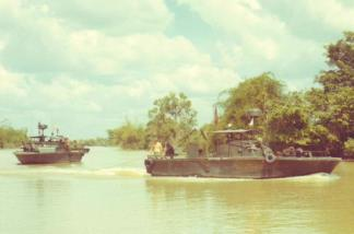 PBRs of the Navy's 549th River Division proceed along the Saigon River, approximately 7km southeast of Dau Tieng, during Operation Tom Sawyer.