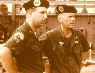 Captain Arthur Price, commander of the River Patrol Force (Task Force 116), confers with a sailor of River Assault Division 54.