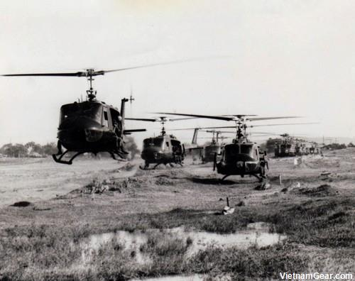 UH-1D helicopters, carrying members of the of the 3rd Battalion, 8th Infantry, 4th Infantry Division, lift off from Camp Radcliff for a combat assault.