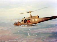 Two UH-1 'Slick' Helicopters flying over the Mekong Delta.