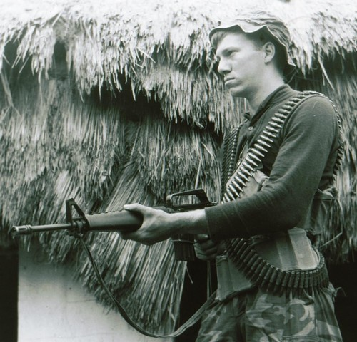 "A trooper of the 101st Airborne wears a wool sweater and ERDL tropical combat trousers whilst on a short-range patrol near Fire Support Base ""Sabre""."
