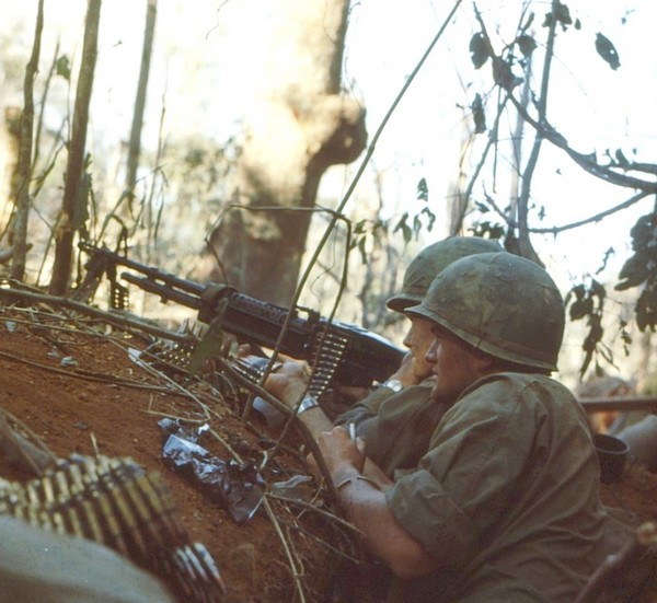 A machine gun team of Company B, 4th Battalion, 173rd Airborne in action against entrenched North Vietnamese positions on Hill 875 near Dak To (Central Highlands).