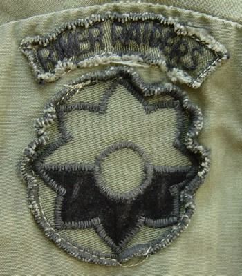 Locally made subdued version of the 9th Infantry Division's insignia with a River Raiders tab.
