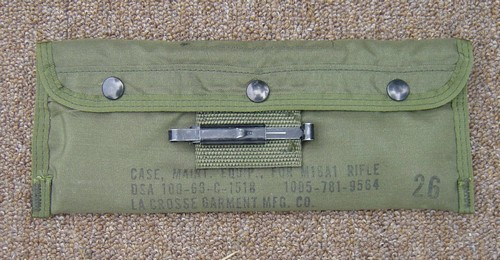 The nylon M16 Cleaning Equipment Pouch was closed by three snap fasteners and featured a single slide keeper.