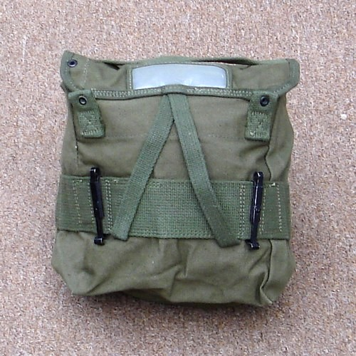 When not in use the item securing straps could be pushed back inside the M1956 field pack.