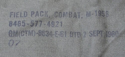Nomenclature and contract stamp on the underside of the side flaps of the M1956 field pack.