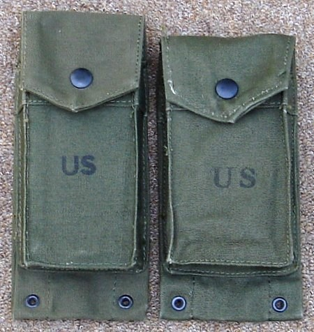 A 1967 dated 'long' ammunition pocket on the left and a 1962 'short' version on the right.