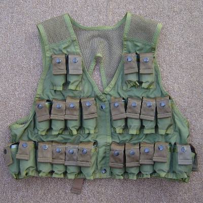 The 1967 designed M79 Grenade Vest had a capacity of 24 rounds - all on the front.