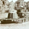 Ironclad craft of the Riverine Assault Force and soldiers of the 9th Infantry Division in the Mekong Delta