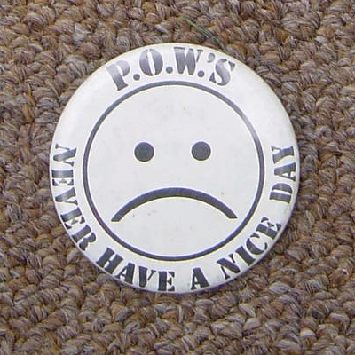 POWs Never Have A Nice Day badge.