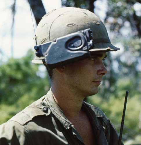 A member of the 22nd Infantry, 4th Infantry Division wears the PRR-9 Helmet mounted receiver.