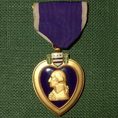 The Purple Heart contains a side profile of George Washington.