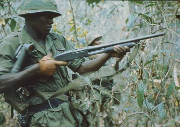 A member of the 2nd Battalion, 27th Infantry, 25th Infantry Division fires his pump action shotgun during Operation Junction City.