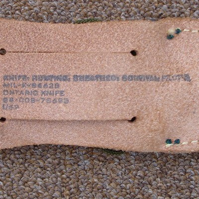 Stamp on the back of the pilot's survival knife sheath.