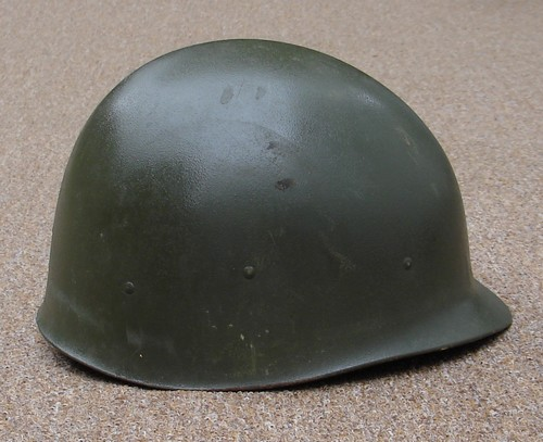 Side view of the P64 Infantry M1 Helmet Liner.